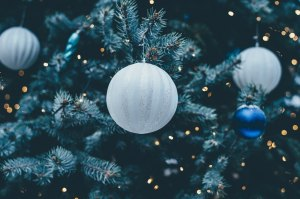 Christmas tree with blue, white and silver baubles.